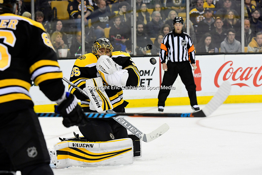 April 7, 2018: Boston Bruins goaltender Anton Khudobin (35) makes a save during the NHL game between the Ottawa Senators  and the Boston Bruins held at TD Garden, in Boston, Mass. Boston defeats Ottawa 5-2 Eric Canha/CSM