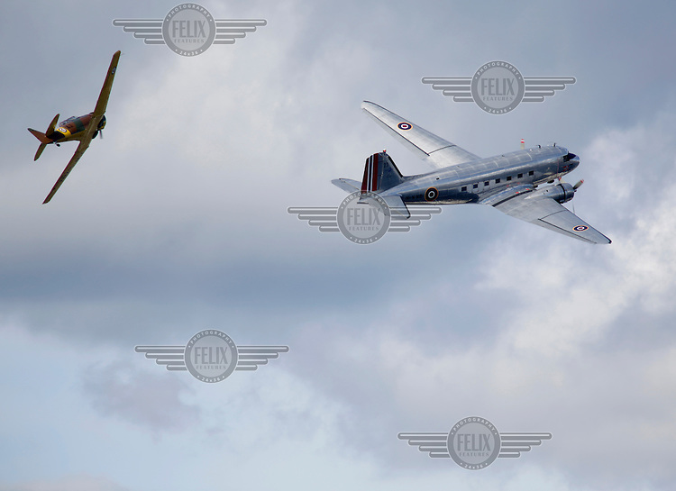 """?""""Dakota"""", Douglas Aircraft Company,  C-47  followed by a ?North American Aviation """"Harvard"""" display over over Oslo as The Royal Norwegian Air Force celebrate """"100 years of airpower""""."""