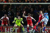 Jack Sowerby of Fleetwood Town blocks the shot of Mihai Dobre of Rochdale during the Sky Bet League 1 match between Rochdale and Fleetwood Town at Spotland Stadium, Rochdale, England on 20 March 2018. Photo by Thomas Gadd.