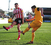 Northampton Town's David Buchanan clears under pressure from Lincoln City's Harry Anderson<br /> <br /> Photographer Andrew Vaughan/CameraSport<br /> <br /> The EFL Sky Bet League Two - Lincoln City v Northampton Town - Saturday 9th February 2019 - Sincil Bank - Lincoln<br /> <br /> World Copyright &copy; 2019 CameraSport. All rights reserved. 43 Linden Ave. Countesthorpe. Leicester. England. LE8 5PG - Tel: +44 (0) 116 277 4147 - admin@camerasport.com - www.camerasport.com