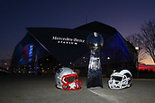 January 29th 2019, Atlanta, Georgia, USA;  A General view of the Vince Lombardi Trophy and a New England Patriots helmet and a Los Angeles Rams helmet outside of Mercedes Benz Stadium during Super Bowl LIII week at dusk on January 29, 2019 in Atlanta, GA.