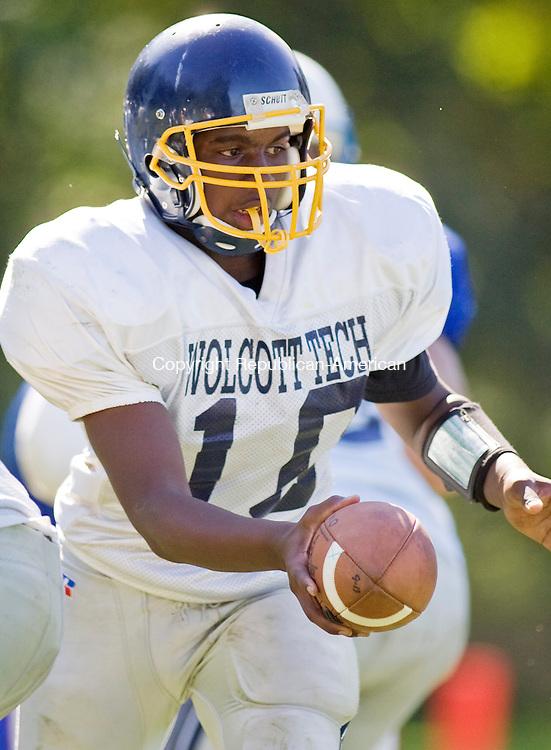 WOODBURY--20 September 2008--092008TJ29 - Wolcott Tech quarterback Trevor Carlson (10) hands the balloff as Nonnewaug High School beats Wolcott Technical High School 50-22 on Saturday, September 20, 2008. (T.J. Kirkpatrick/Republican-American)