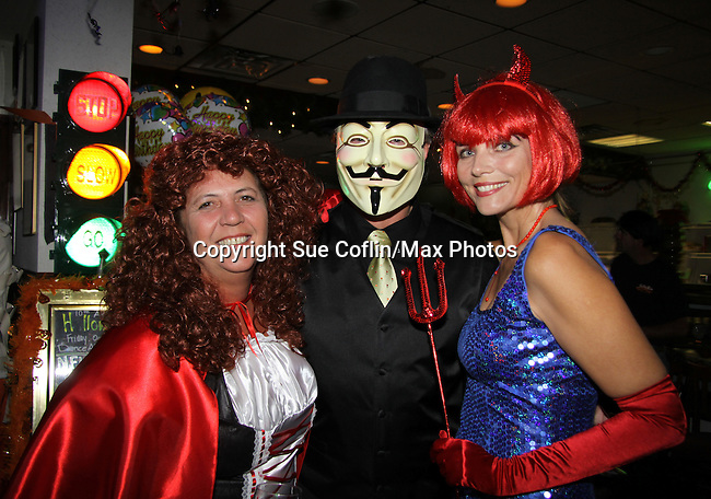 Guiding Light's Frank Dicopoulos and his wife Teja Anderson are host and judge of the Halloween party on October 30, 2010 at Sallee Tee's Grille in Monmouth Beach, New Jersey. They pose with Diane of Salle Tee's Grille. He has a Vedetta mask on and Teja is the blue Devil. (Photo by Sue Coflin/Max Photos)