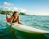 USA, Hawaii, The Big Island, portrait of a lifeguard on her surfboard at the Mauna Kea Hotel