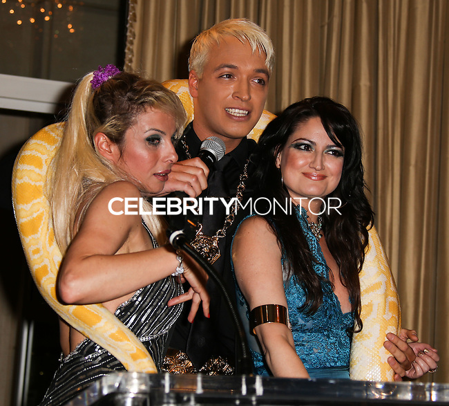 BEVERLY HILLS, CA, USA - MARCH 28: Sabrina Parisi, KUBA Ka, Vikki Lizzi at the Versace Unveiling Of The 1st Pop Recording Artist Superhero - KUBA Ka's Performance Outfits. Designed by the legendary fashion hosuse - Donatella Versace. For the Benefit of the Face Forward Foundation (Plastic Surgery for Destroyed Faces from Violence). Pop entertainer TV personality KUBA Ka, together with VERSACE, unveiled Kuba Ka's new Versace images, for the First Pop Artist/Superhero of the World. He has become the inspiration of Donatella's newest and wildest creations and will celebrate the launch of his new power house conglomerate - KUBA Ka Empire Inc. in collaboration with the sensational fashion house - VERSACE on Friday, his birthday at a red carpet media and celebrity event at the luxurious Peninsula Hotel in Beverly Hills held at the Peninsula Hotel on March 28, 2014 in Beverly Hills, California, United States. (Photo by Xavier Collin/Celebrity Monitor)