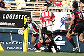 Lelia Masaga tries to break out of Paul Williams tackle during the Ranfurly Shield challenge against Canterbury at Jade Stadium on the 10th of September 2006. Canterbury won 32 - 16.