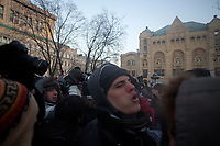A member of the unregistered Libertarian Party in Russia stands in the crowd after escaping arrest during an unsanctioned protest at Lubyanka Square in Moscow, Russia.