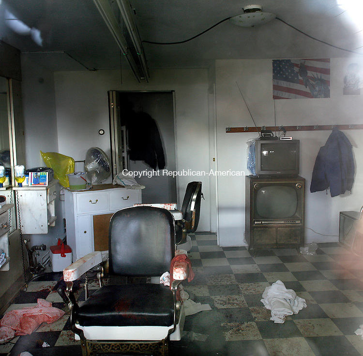 Waterbury, CT-30, December 2009-123009CM12 -- Inside the barber shop on Hillside St., in Waterbury was the scene of a horrible event.  Christopher Massa Republican-American