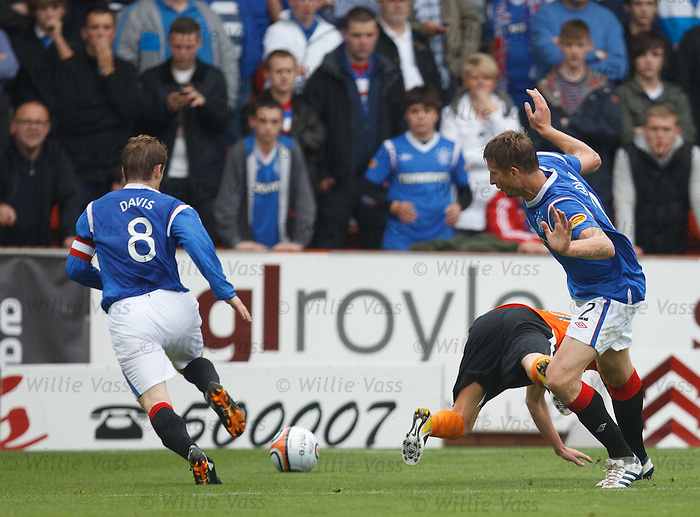 Danny Swanson falls over Dorin Goian's leg and dives in the box