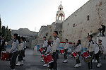 Palestinian Christian's Scouts march in the Manger Suare next to the Church of the Nativity, the traditionally excepted birthplace of Jesus Christ, during the annual Christmas celebrations in the west Bank town of Bethlehem, 24 December 2009. The head of the Roman Catholic Church in the Holy Land, Patriarch Fouad Twal, arrived in Bethlehem, ahead of Christmas celebrations in the city revered as the birthplace of Jesus Christ. Photo by Najeh Hashlamoun