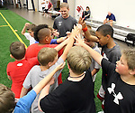 SIOUX FALLS, SD - JULY 2:  Kurtiss Riggs, center, watches campers come together as a team at the Riggs Football Academy Tuesday night at the Sanford Fieldhouse. (Photo by Dave Eggen/Inertia)