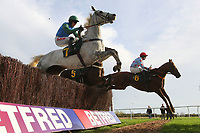 Aneyeforaneye ridden by Brian Hughes (R) an Dawn Commander ridden by Jason Maguire in jumping action during the October Handicap Chase