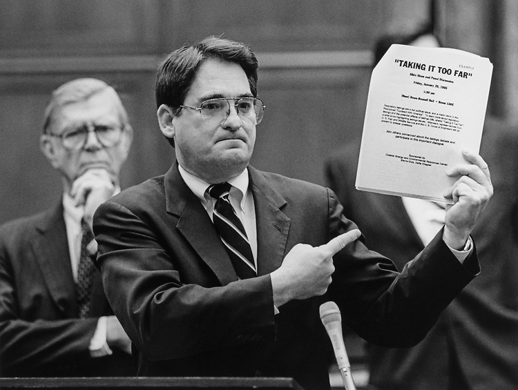 Rep. William F. Clinger, R-Pa., and Rep. Billy Tauzin, R-La., holding an anti-lobbying bill on March 14, 1996. (Photo by Rebecca Roth/CQ Roll Call)