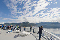 Tourists on board the deck of the Matanuska Ferry, enroute from Sitka to Juneau.