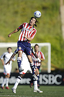Chivas USA midfielder Sacha Kljestan (16) heads a ball. The Chivas USA and New England Revolution played to 1-1 draw during a early round match of the 2008 SuperLiga at Cal State Fullerton Titan stadium in Fullerton, California on Sunday July 20, 2008.