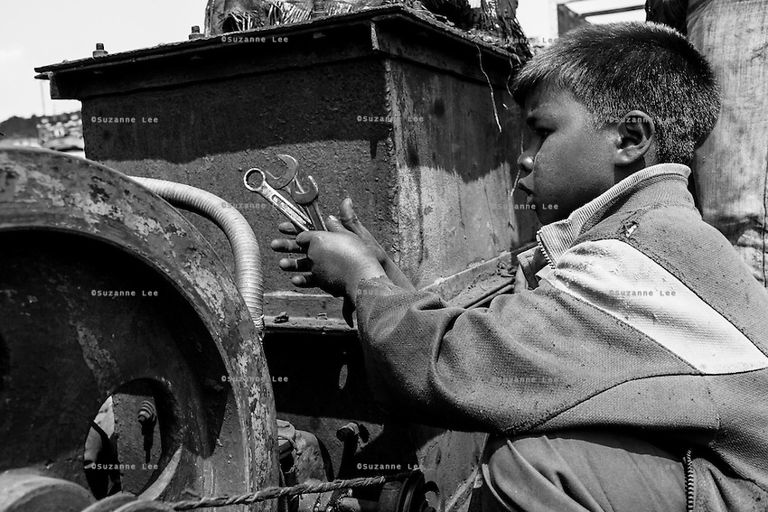 In Jaintia Hills, underaged children work in unscientific, largely unmonitored and extremely dangerous underground coal mines dug out by often trafficked children using primitive methods and tools. The north eastern Indian state of Meghalaya sits on about 640 million tons of coal, with 40 million tons of that in Jaintia Hills alone which has about 5000 privately owned mines.  Photo by Suzanne Lee for Panos London
