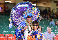 August 03, 2012 - Cardiff England - United Kingdom - A couple of Japan Football team fans in the stands before Group F match between JPN and BRA at the Millennium Stadium. .