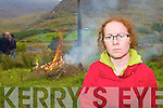 Clara Leahy-Breen from Glenbeigh anti-mast protest group sets fire to a dummy mast at the site of the planned mast by 3G on Friday