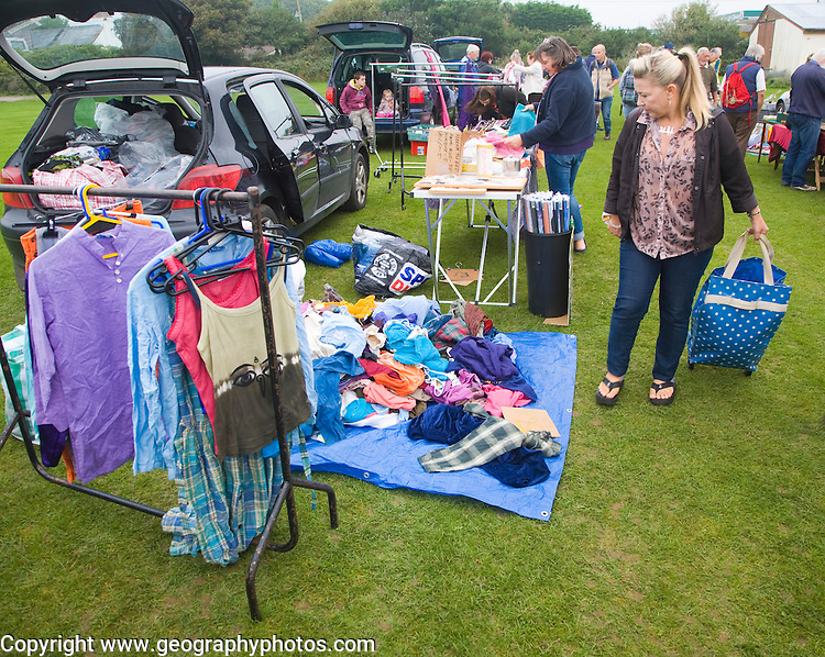 Clothing on display at a car boot sale, UK