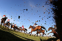 The field in jumping action during the Domenico Adorno 85th Birthday Novices' Handicap Hurdle