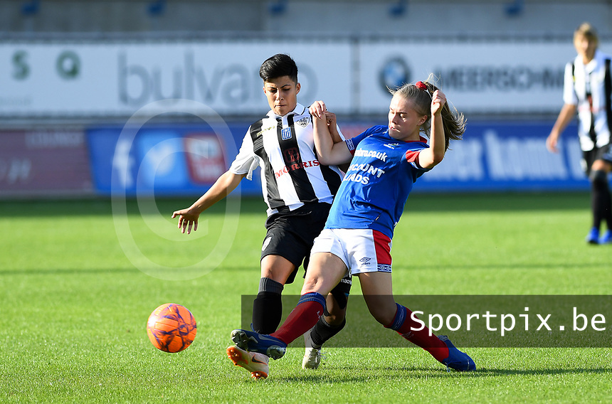 20190810 - DENDERLEEUW, BELGIUM : PAOK's Anastasia Gkatsou (left) pictured in a fight for the ball with Linfield's Casey Howe (r) during the female soccer game between the Greek PAOK Thessaloniki Ladies FC and the Northern Irish Linfield ladies FC , the second game for both teams in the Uefa Womens Champions League Qualifying round in group 8 , Wednesday 7 th August 2019 at the Van Roy Stadium in Denderleeuw  , Belgium  .  PHOTO SPORTPIX.BE | DAVID CATRY