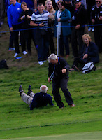 Ian Poulter (EUR) throws a golf ball to the crowd and two dive to get it during the Sunday Singles Matches of the Ryder Cup at Gleneagles Golf Club on Sunday 28th September 2014.<br /> Picture:  Thos Caffrey / www.golffile.ie