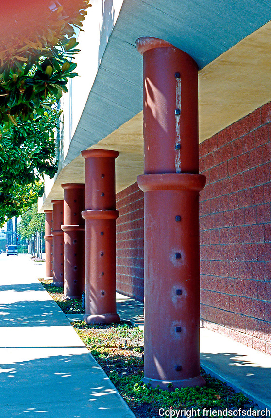 """Eric Owen Moss: Ince St. Facade of Gary Office Group. Use of sewer pipe as """"minoan"""" columns, looking west. Photo 1999."""