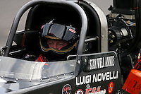 Sep 28, 2013; Madison, IL, USA; NHRA top fuel dragster driver Luigi Novelli during qualifying for the Midwest Nationals at Gateway Motorsports Park. Mandatory Credit: Mark J. Rebilas-