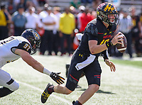 College Park, MD - September 9, 2017: Maryland Terrapins quarterback Max Bortenschlager (18) avoids the sack during game between Towson and Maryland at  Capital One Field at Maryland Stadium in College Park, MD.  (Photo by Elliott Brown/Media Images International)