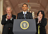 Washington, D.C. - May 26, 2009 -- United States President Barack Obama, center, smiles as he recognizes Celina Sotomayor, mother of Judge Sonia Sotomayor of the Federal Appeals Court, (not pictured), his nominee for Justice of the U.S. Supreme Court in the East Room of the White House on Tuesday, May 26, 2009.  Vice President Joseph Biden, left, and Judge Sotomayor, right, applaud the mention. Judge Sotomayor, 54, of The Bronx, New York, will be the first Hispanic to serve if her nomination is approved by the U.S. Senate, replacing retiring Justice David Souter. .Credit: Ron Sachs / Pool via CNP