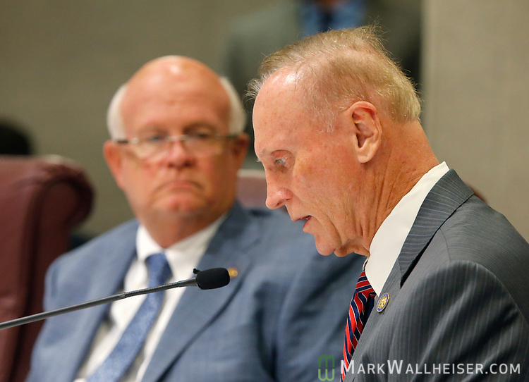 Senator David Simmons (R-Longwood), right, reads a bill during the Florida Senate Committee on Criminal Justice meeting as Senator Dennis Baxley (R-Lady Lake) looks on at the Florida Capitol in Tallahassee Florida March 13, 2017.