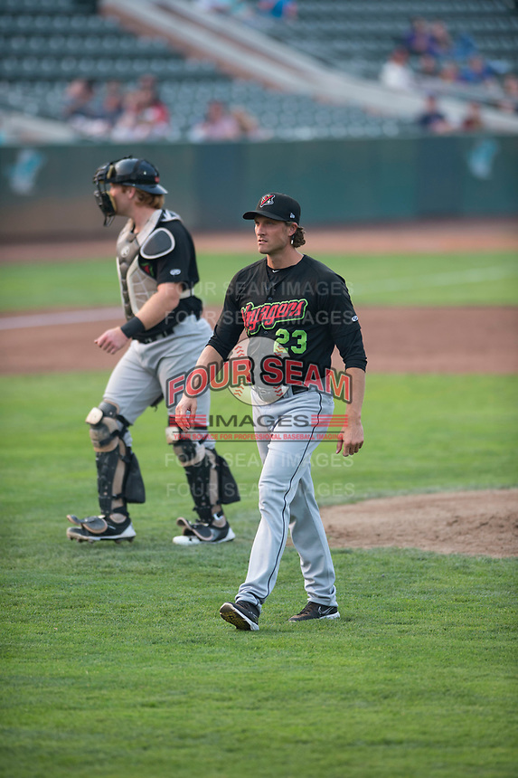 Great Falls Voyagers pitching coach John Ely (23) walks off the field in front of catcher Gunnar Troutwine (33) after a visit to the mound during a Pioneer League against the Ogden Raptors at Lindquist Field on August 23, 2018 in Ogden, Utah. The Ogden Raptors defeated the Great Falls Voyagers by a score of 8-7. (Zachary Lucy/Four Seam Images)