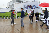 Mikko Ilonen (FIN) takes a snap of Paul McGinley (IRL) and Justin Rose (ENG) on the tandem bike against Ian Poulter (ENG) and Wu Ashun (CHN) in the BMW i8 for a challenge during Wednesday's Pro-Am Day of the 2014 BMW Masters held at Lake Malaren, Shanghai, China 29th October 2014.<br /> Picture: Eoin Clarke www.golffile.ie