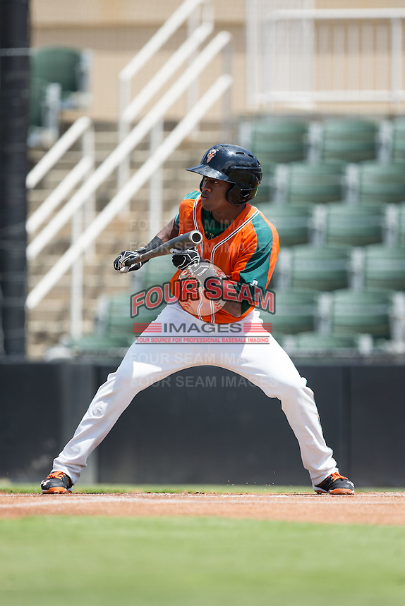 Anfernee Seymour (12) of the Greensboro Grasshoppers squares to bunt against the Kannapolis Intimidators at Intimidators Stadium on July 17, 2016 in Greensboro, North Carolina.  The Intimidators defeated the Grasshoppers 3-2 in game one of a double-header.  (Brian Westerholt/Four Seam Images)