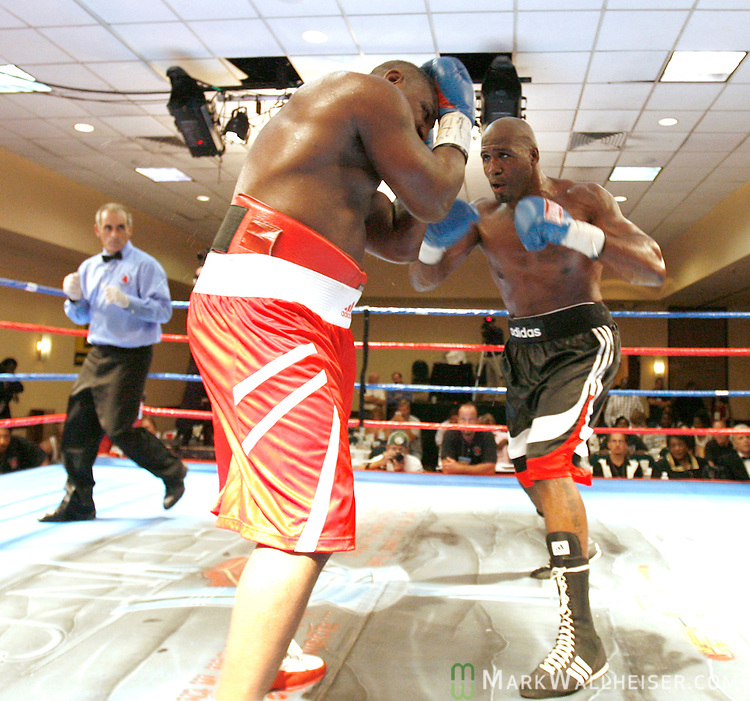 Tallahassee fighter Travis Walker, right, throws a series of punches on Andrew Greeley, of Monroe, LA., in a heavyweight bout at the DoubleTree Hotel in Tampa August 19, 2006.