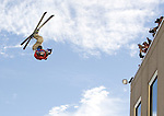 In this photo provided by the Reno Sparks Convention and Visitor's Authority, Shane McConkey performs an urban Ski-BASE jump off a ramp built on the roof of the Silver Legacy hotel casino in downtown Reno, Nev., Saturday Nov. 17, 2007. The stunt was to promote the local premier of the 2007 Warren Miller ski movie Playground and to raise money for the Make-a-Wish foundation, which helps make wishes come true for seriously ill children.(Reno Sparks Convention and Visitor's Authority)