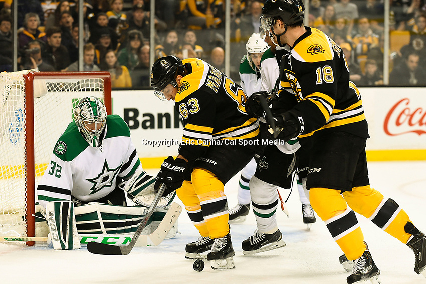 February 10, 2015 - Boston, Massachusetts, U.S. - Boston Bruins left wing Brad Marchand (63) kicks the puck up to his skate for a shot on Dallas Stars goalie Kari Lehtonen (32) during the NHL match between the Dallas Stars and the Boston Bruins held at TD Garden in Boston Massachusetts. Dallas defeats Boston 5-3 in regulation time. Eric Canha/CSM