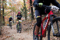 NWA Democrat-Gazette/CHARLIE KAIJO Riders compete during a bike race, Sunday, November 4, 2018 at Lake Leatherwood MTB Park in Eureka Springs.<br />