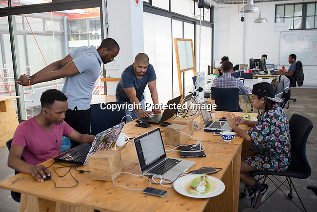 "CAPE TOWN, SOUTH AFRICA NOVEMBER 22: Techies work in a shared office space called ""Woodstock Exchange"", where entrepreneurs and small businesses rent office space on November 22, 2016 in Woodstock outside central Cape Town, South Africa. (Photo by: Per-Anders Pettersson)"