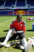 New York Red Bulls goalkeeper Bouna Coundoul (18) takes his shoes off at the end of a practice at Red Bull Arena in Harrison, NJ, on March 16, 2010.