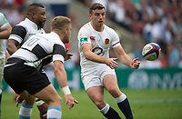 Twickenham, Surrey, United Kingdom. George FORD, releases the ball as Steffon ARMITAGE and Ian MADIGAN move to tackle,  during the, Old Mutual Wealth Cup, England vs Barbarian's match, played at the  RFU. Twickenham Stadium, on Sunday   28/05/2017England    <br /> <br /> [Mandatory Credit Peter SPURRIER/Intersport Images]