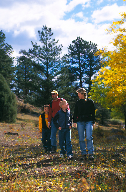 A family hiking among the autumn color in the Rocky Mountains of Colorado