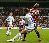 Leeds United's Tyler Roberts vies for possession with Brentford's Kamohelo Mokotjo<br /> <br /> Photographer Alex Dodd/CameraSport<br /> <br /> The EFL Sky Bet Championship - Leeds United v Brentford - Saturday 6th October 2018 - Elland Road - Leeds<br /> <br /> World Copyright &copy; 2018 CameraSport. All rights reserved. 43 Linden Ave. Countesthorpe. Leicester. England. LE8 5PG - Tel: +44 (0) 116 277 4147 - admin@camerasport.com - www.camerasport.com