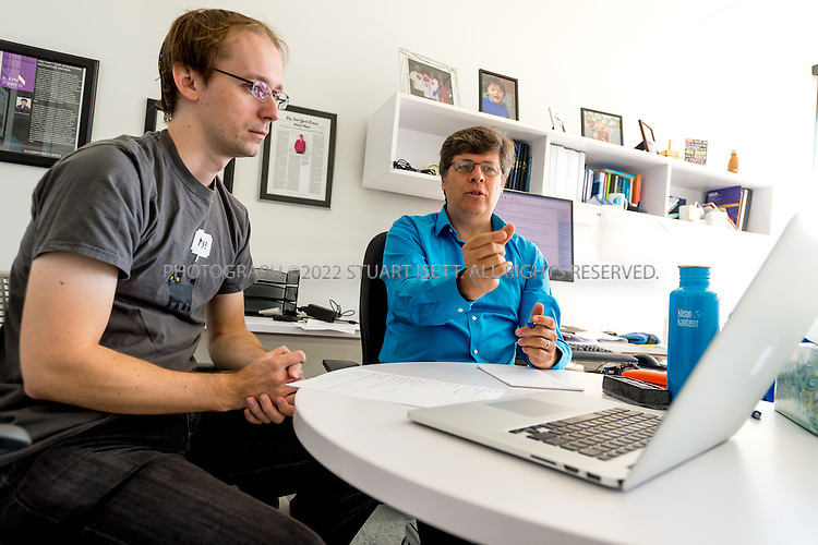 SEATTLE, USA - SEPTEMBER 16th, 2015<br /> <br /> Dr. Oren Etzioni (right), Chief Executive Officer of the Allen Institute for Artificial Intelligence meets with Dirk Groeneveld (left), a Senior Software Engineer, in Etzioni&rsquo;s office at the institute&rsquo;s office in Seattle, WA, USA. <br /> <br /> The Allen Institute for Artificial Intelligence (abbreviated AI2) is a research institute funded by Microsoft co-founder Paul Allen to achieve scientific breakthroughs by constructing AI systems with reasoning, learning and reading capabilities. Oren Etzioni was appointed by Paul Allen in September 2013 to direct the research at the institute.<br /> <br /> (Photo by Stuart Isett for The Washington Post)