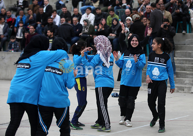 Palestinian female players of al-Nasr al-Arabi club, compete with players of Amwaj society club, during final baseball match, in Gaza city on January 31, 2019. Photo by Mahmoud Ajjour