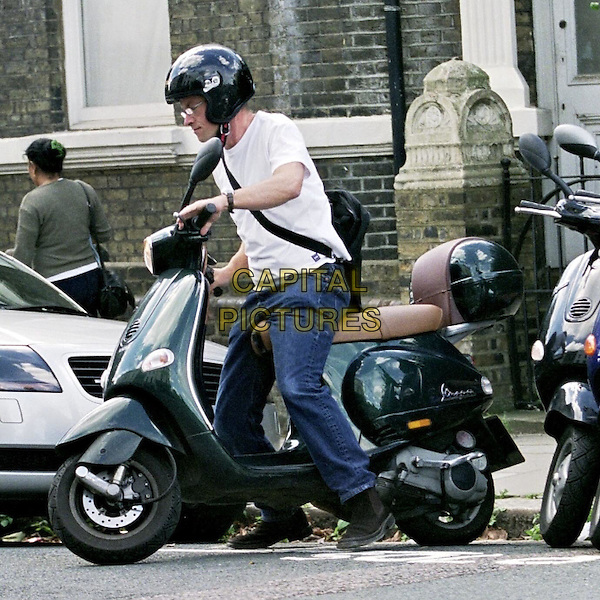 **EXCLUSIVE PICTURES**.FUNNY MAN HARRY ENFIELD OUT AND ABOUT IN LONDONS PRIMROSE HILL DOING SOME RETAIL THERAPY AFTER HIS NEW TV SHOW WAS SLATED IN THE PAPERS.AFTER WALKING AROUND SEVERAL SHOPS HE HAD A LOOK IN AN ESTATE AGENTS THEN HEADED OFF BY SCOOTER TO HIS NEWLY REFURBISHED HOUSE IN BAYSWATER. .www.capitalpictures.com.sales@capitalpictures.com.©Capital Pictures