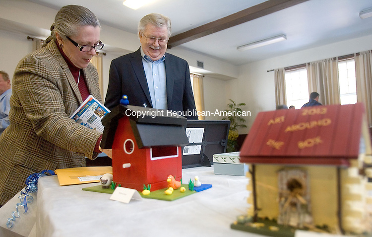 "LITCHFIELD, CT. 10 March 2013-031013SV05-Georgia and Jerry Hickey of Morris check out the birdhouses and boxes during the third annual ""Art Around the Box"" event at the Carriage House at White Memorial Foundation in Litchfield Sunday. The Friends and Board of Directors of the Morris Public Library sponsored the ""Art Around the Box"" social and auction event. All proceeds from the event benefit the Library..Steven Valenti Republican-American"