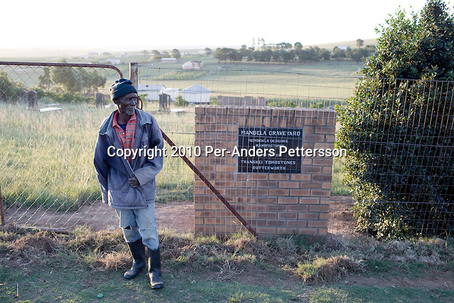 QUNU, SOUTH AFRICA - APRIL 1: Morson Mandela, age 78, stands outside the Mandela family graveyard in the village of Qunu, where Nelson Mandela grew up on April 1, 2010, in Qunu, South Africa. Morson is the little brother of Mandela, (in the extended family) and he is the caretaker for the cemetery. Mr. Mandela was born in Mvezo, about 32 kilometers from here and Qunu and its surroundings is the area where he learned about life including his traditional manhood ceremony. Mr. Mandela was born in 1918, he served as a president of South Africa from 1994-1999, when he retired. Before that he was the leader of the armed wing of ANC and was convicted of sabotage among other crimes and served 27 years in prison, many of them on Robben Island, outside Cape Town. Qunu has a museum and Mr. Mandela has a big house where he and his family spends time while in the area. (Photo by Per-Anders Pettersson)