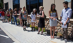 Models line up outside Pixella Studios during a casting call for a fashion show to be held as part of Artown on Saturday, June 15, 2013 in Reno, Nevada.