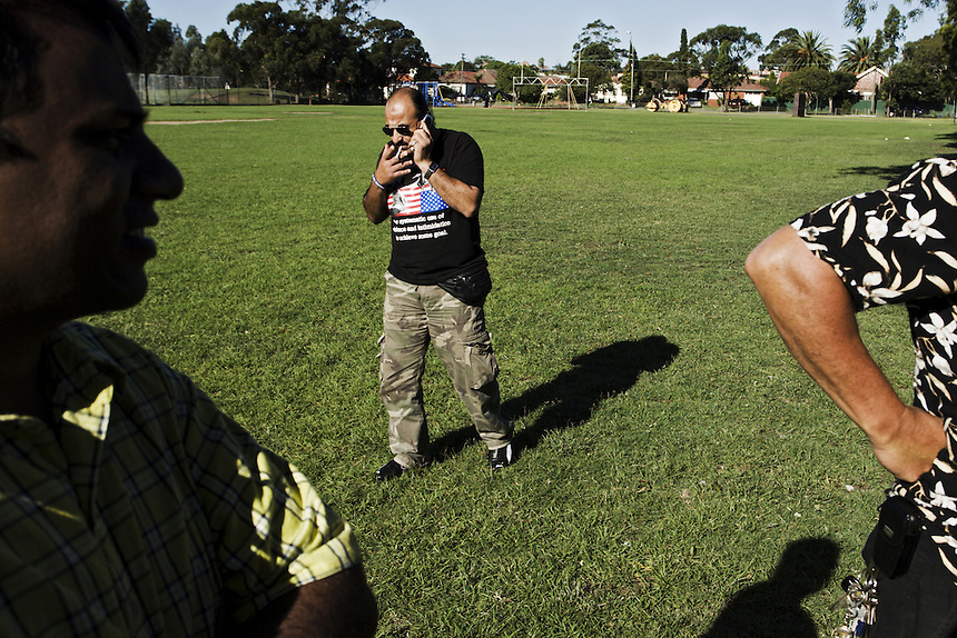 Habib discusses campaign details on his mobile phone during a supporters' barbeque prior to voting day, western Sydney, March 2007.
